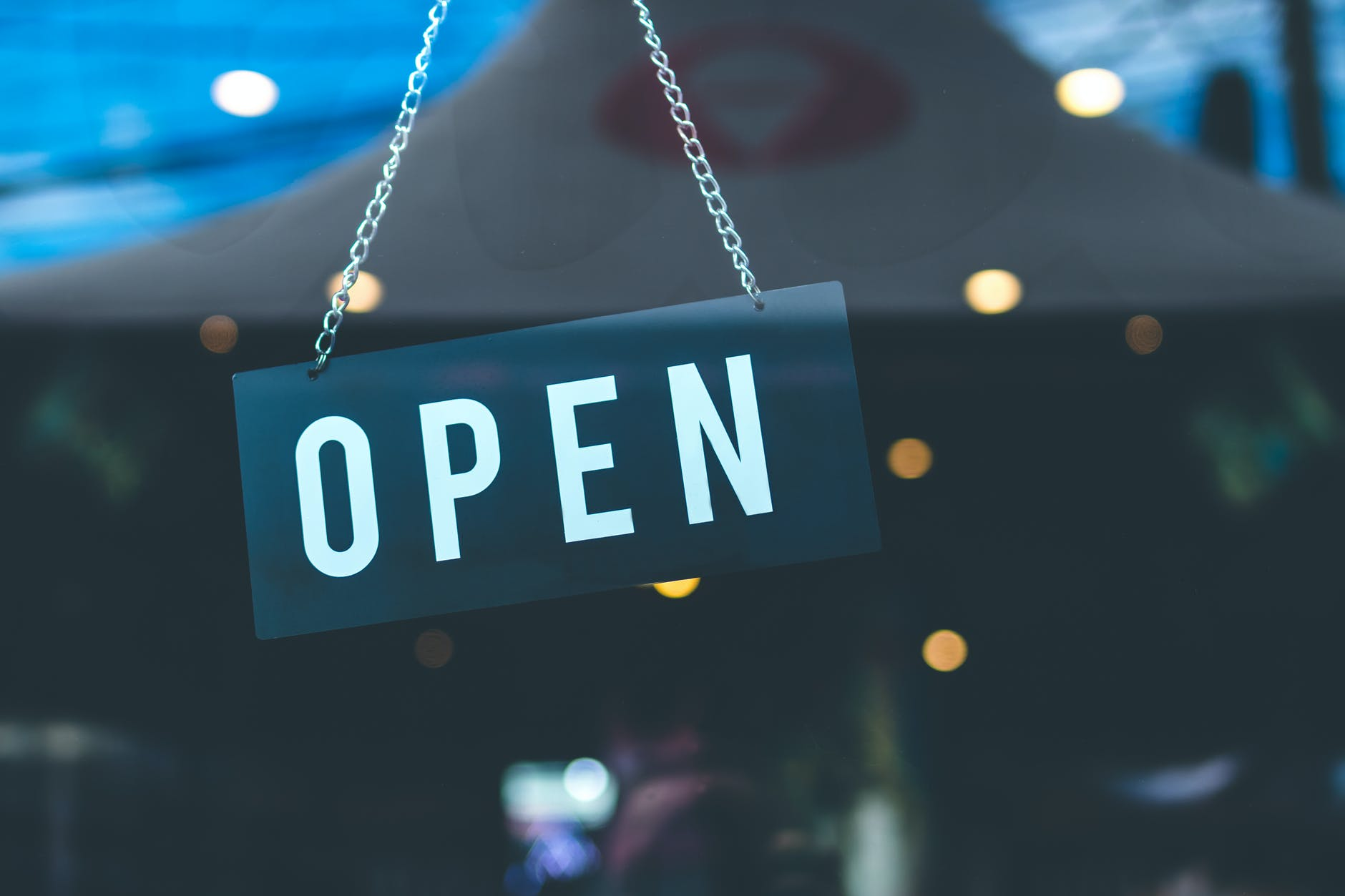 selective focus photography of open signage